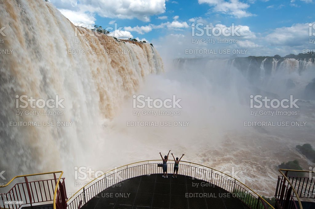 Tourists taken pictures at the main falls on Iguaçu Falls stock photo