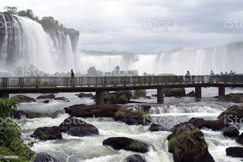 Tourists taking a closer look at Iguassu Falls stock photo