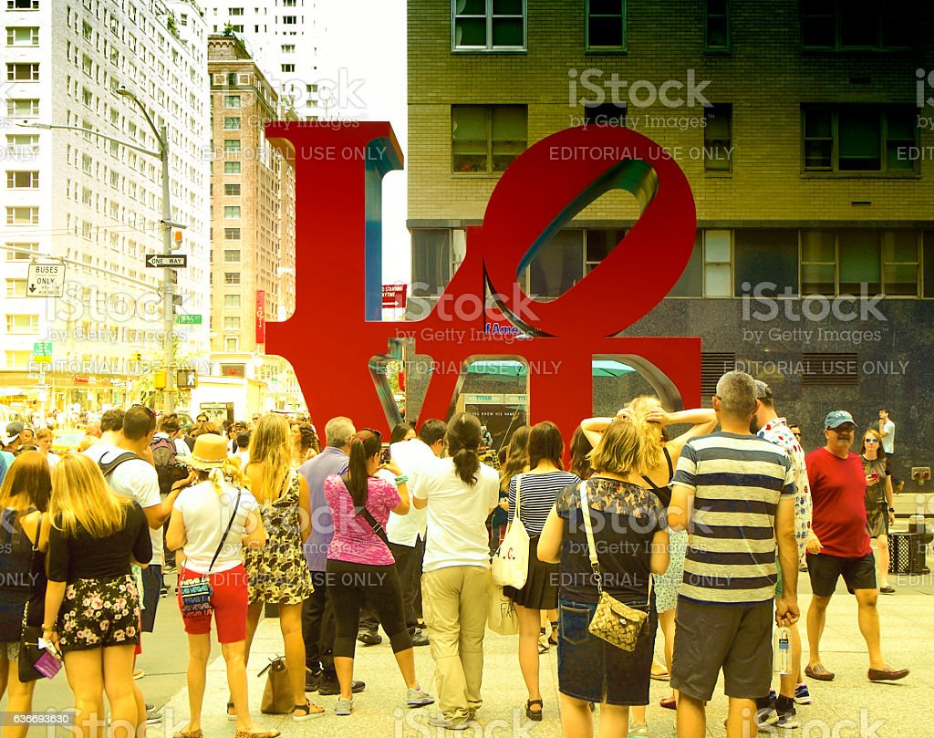 Tourists taking photos to love sculpture in New York stock photo