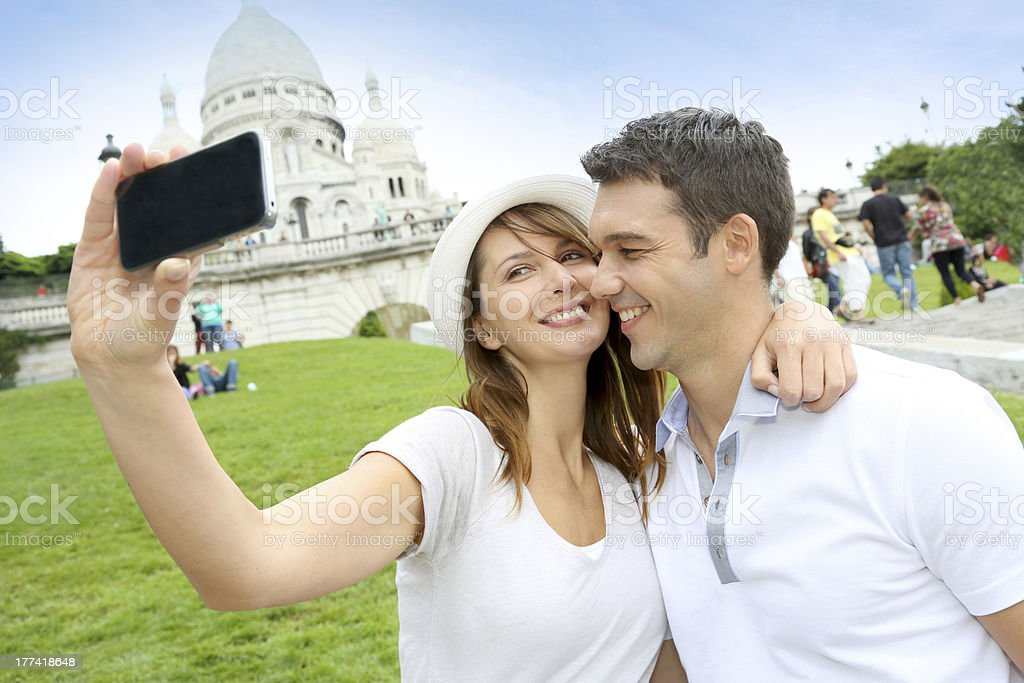 Tourists taking picture in Paris royalty-free stock photo