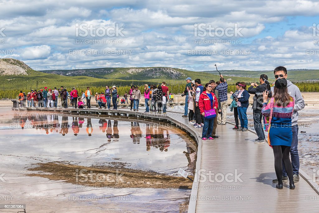 Tourists taking pictures from boardwalk in Grand Prismatic spring stock photo
