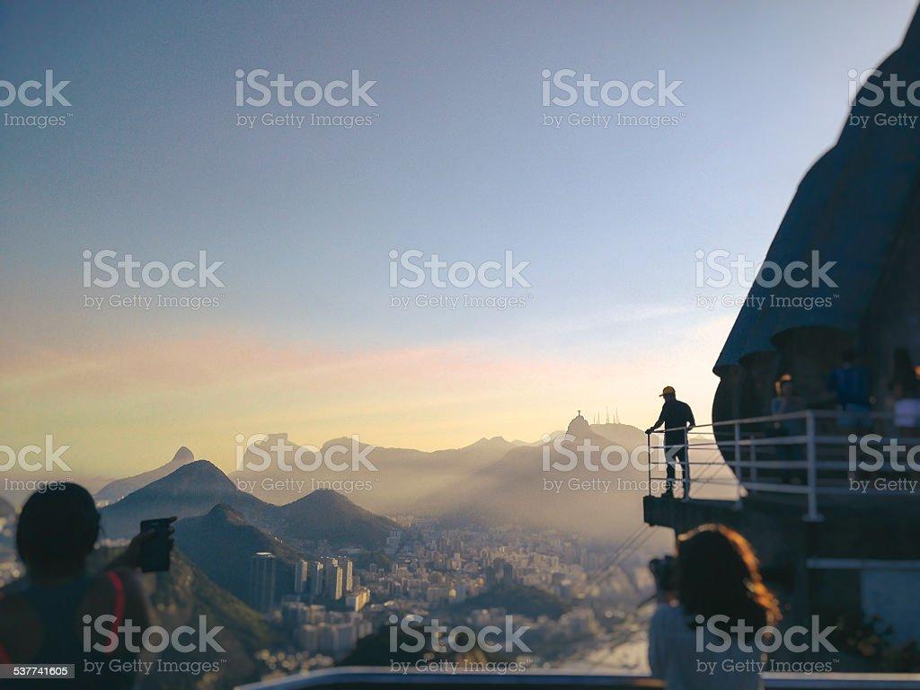 Tourists taking pictures of Rio de Janeiro. stock photo