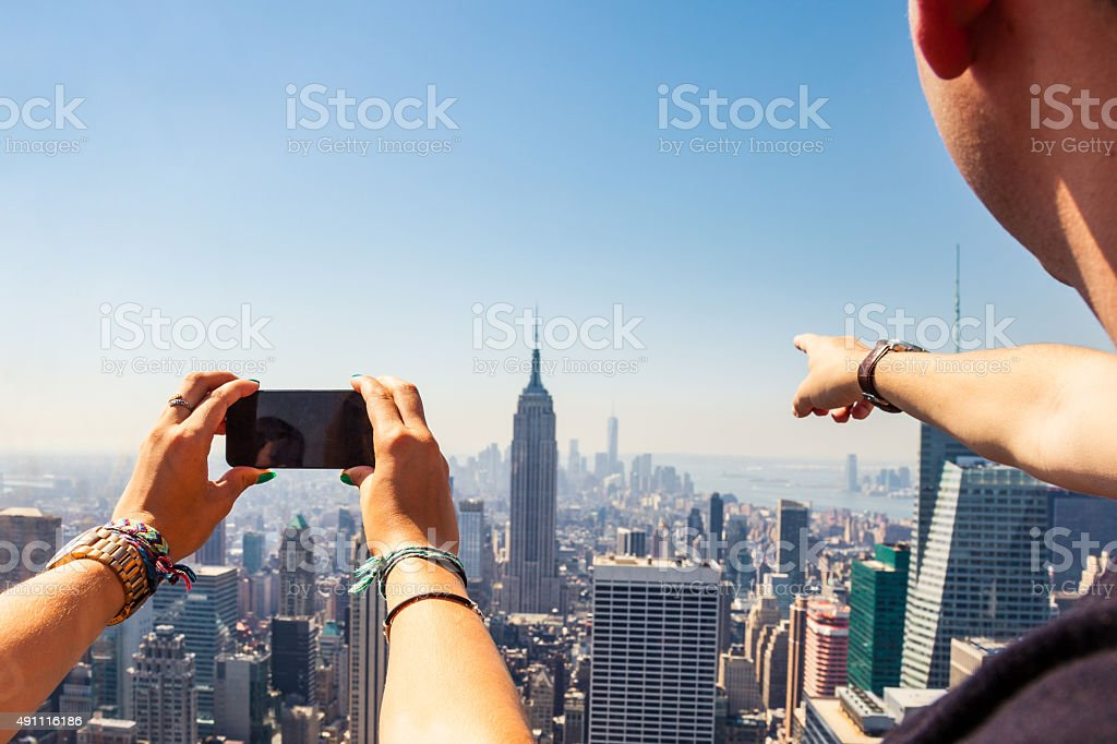 Tourists taking pictures to New York Skyline stock photo