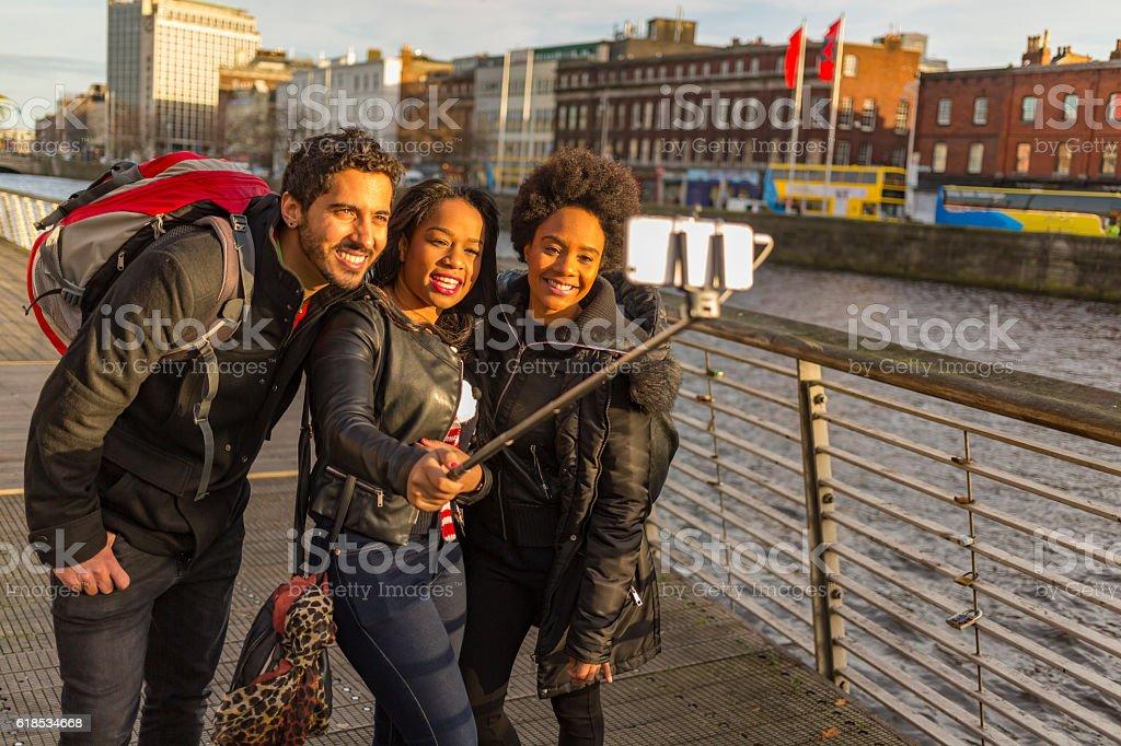 Tourists Taking Selfies on Vacation in Dublin Ireland stock photo