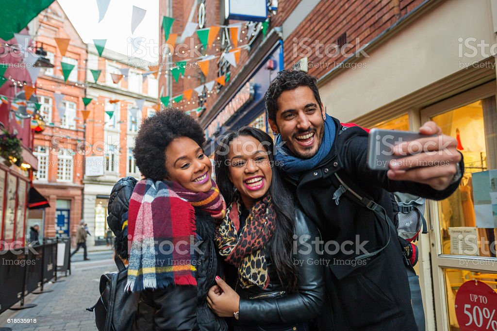 Tourists Taking Selfies on Vacation in Dublin Ireland stock photo