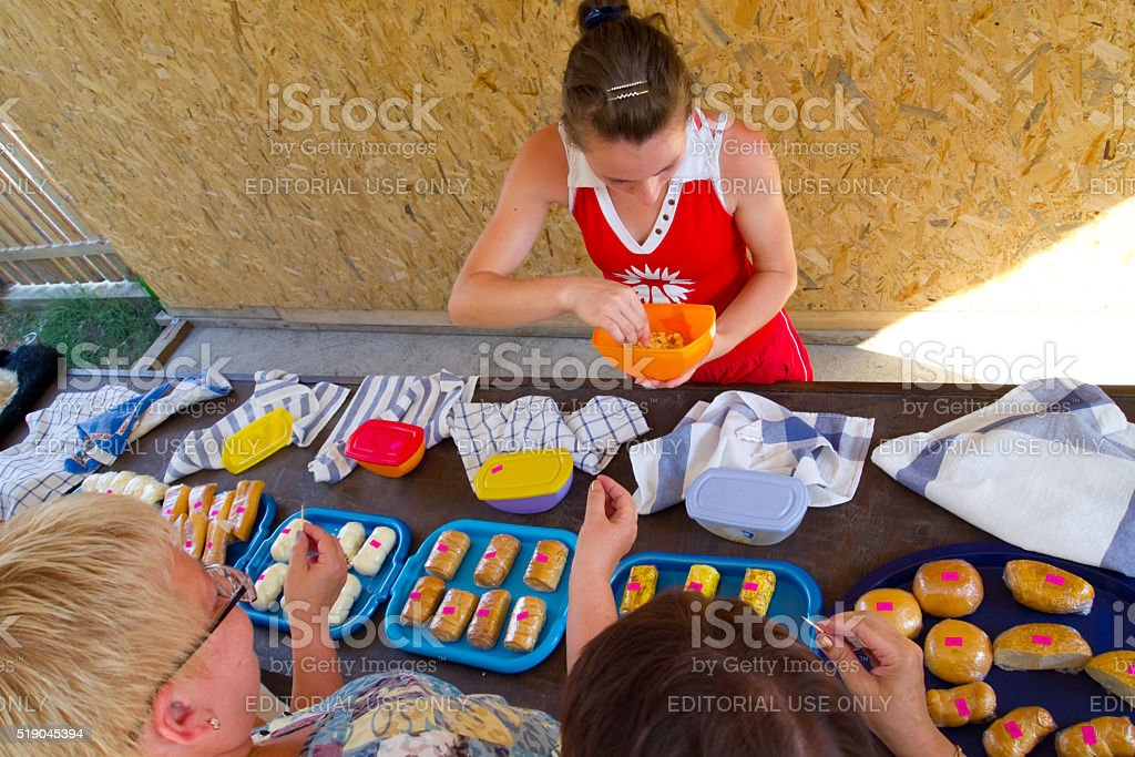 Tourists tasting Adygei cheese on the product presentation stock photo