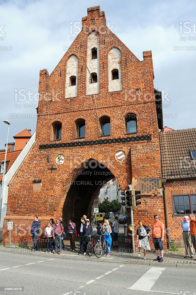 Tourists to cross a road at Stadttor Wassertor (Wismar Germany) stock photo