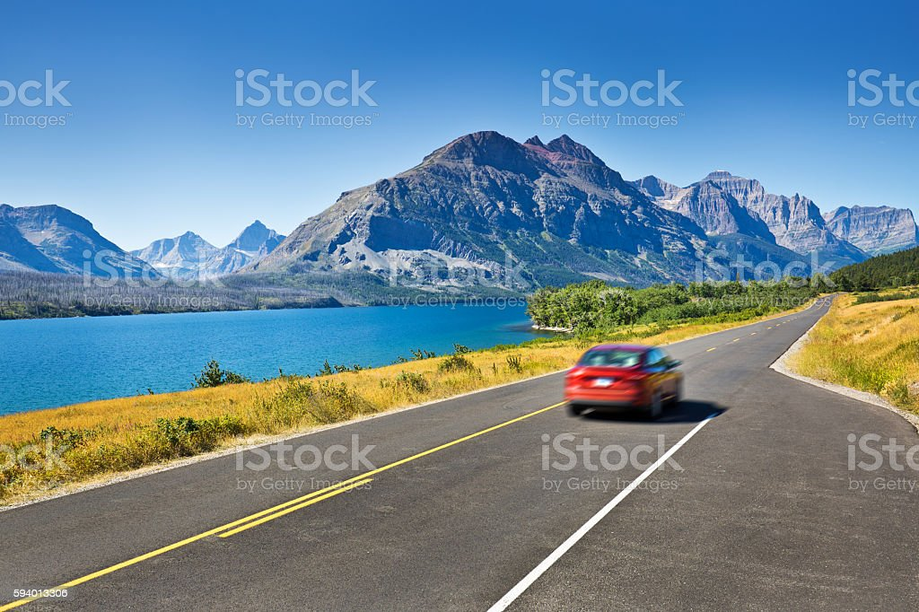 Tourists Touring Glacier National Park in a Driving Road Trip stock photo