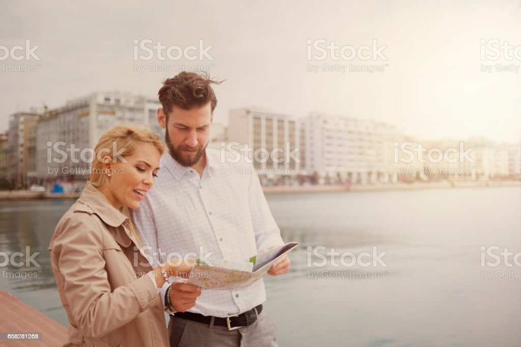 Tourists traveling and holding a map stock photo