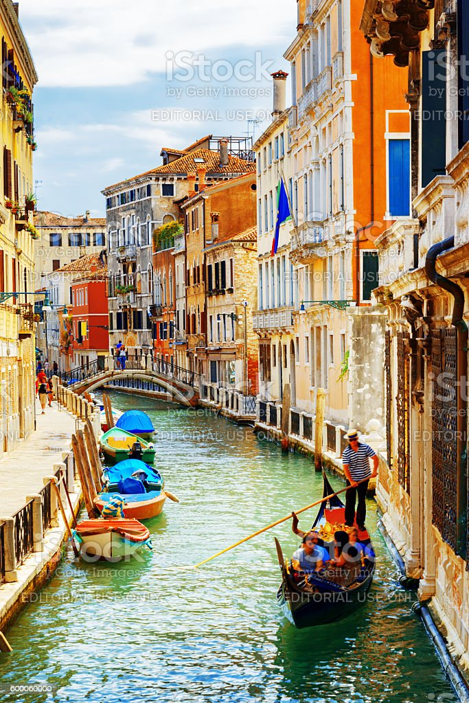 Tourists traveling in gondola, Rio Marin Canal, Venice, Italy stock photo