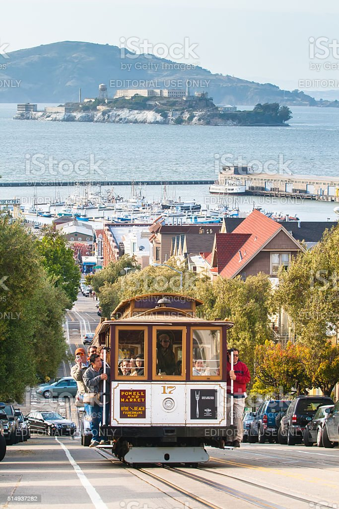 Tourists travelling on a cable car in San Francisco stock photo