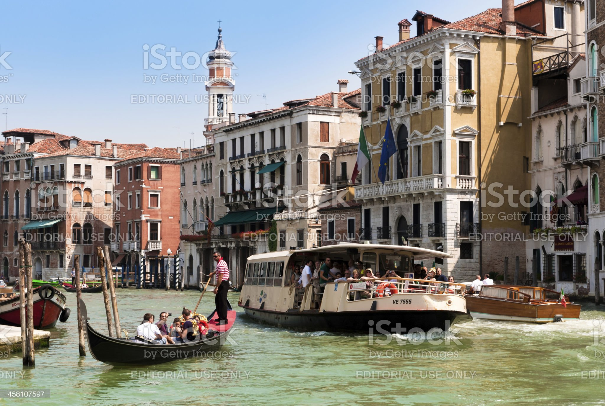 Tourists travelling on gondola and vaporetto at Grand Canal, Venice royalty-free stock photo