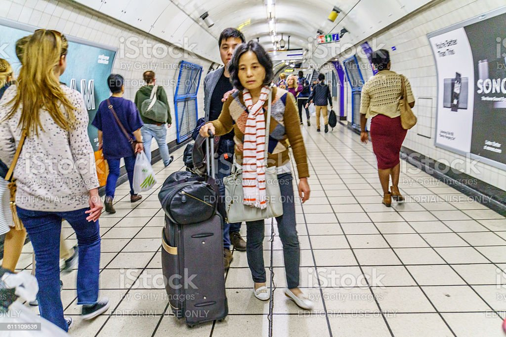 Tourists travelling on London Underground stock photo