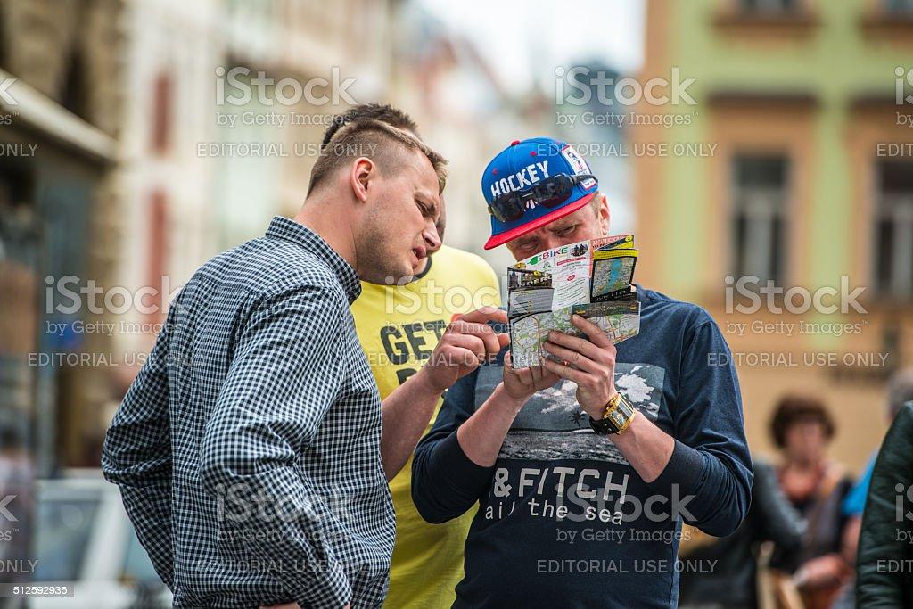 Tourists using city map on Prague Street stock photo