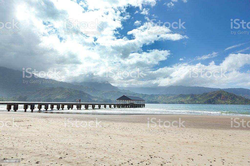 Tourists Vacation at Pier in Hanalei Bay of Kauai, Hawaii stock photo