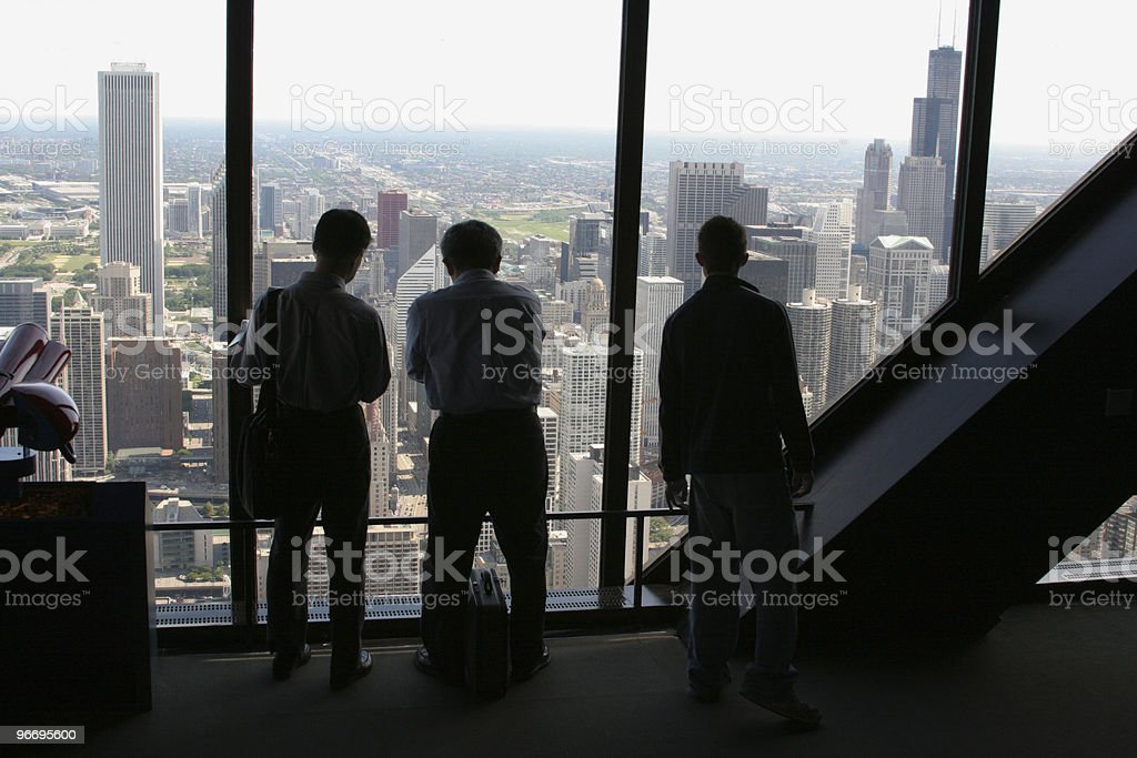 Tourists view Chicago from John Hancock Tower Observatory stock photo