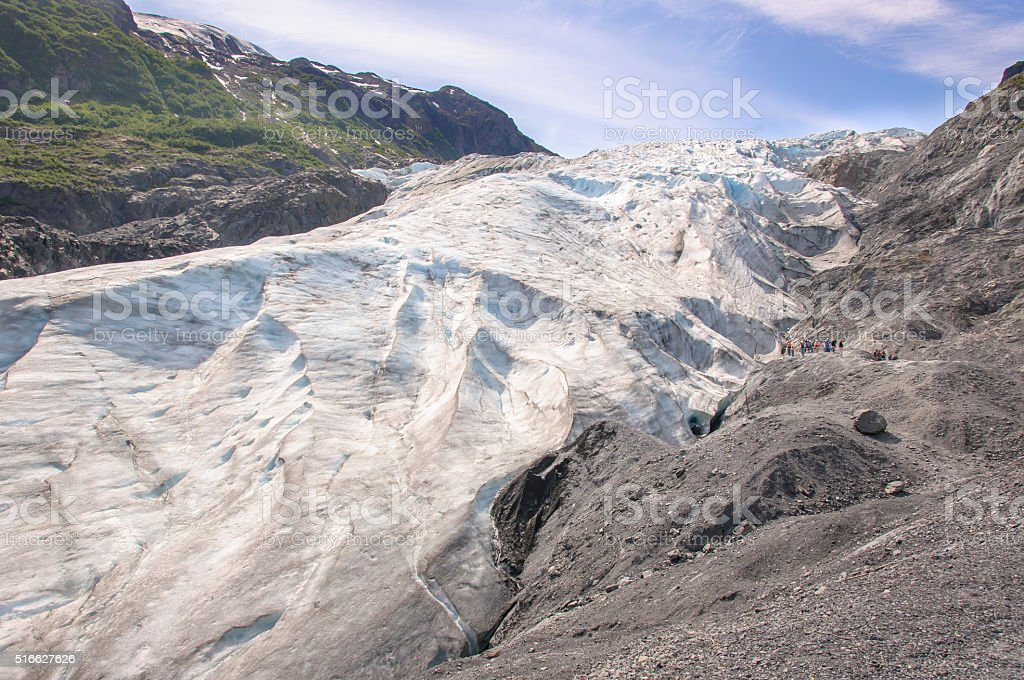 Tourists Viewing Massive Alaska Glacier Close Up stock photo