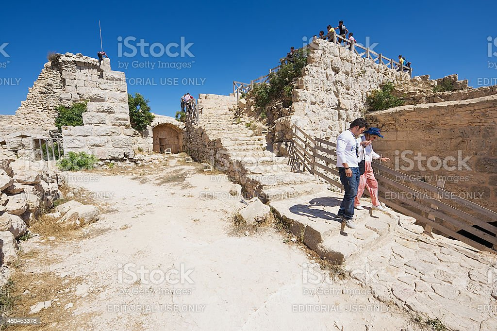 Tourists visit Ajloun fortress in Ajloun, Jordan. stock photo