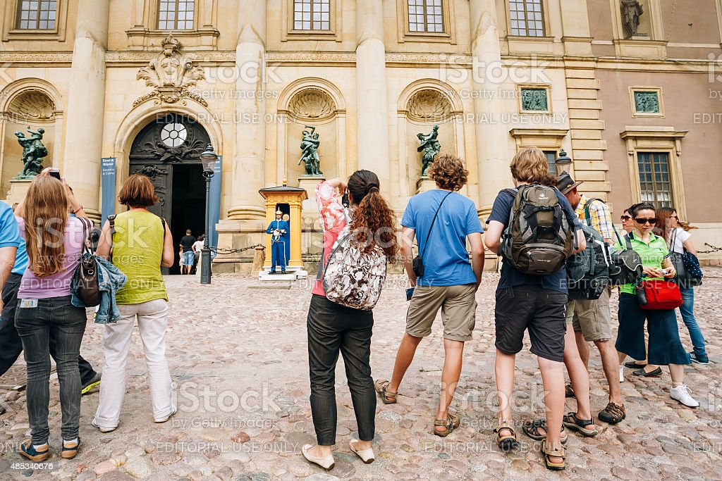Tourists visit and photograph at Royal palace in Stockholm, Sweden stock photo