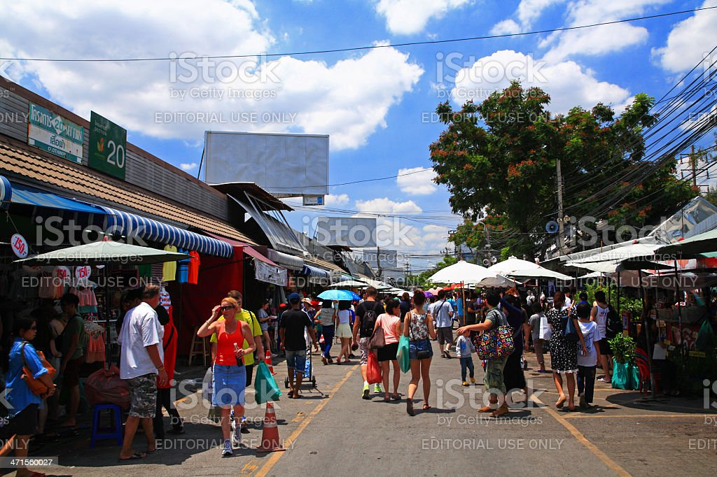 tourists visit Chatuchak weekend shopping market in Bangkok stock photo