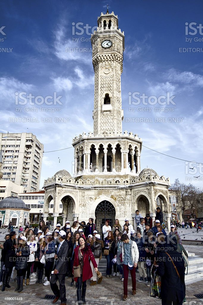 Tourists visit clock tower in izmir royalty-free stock photo