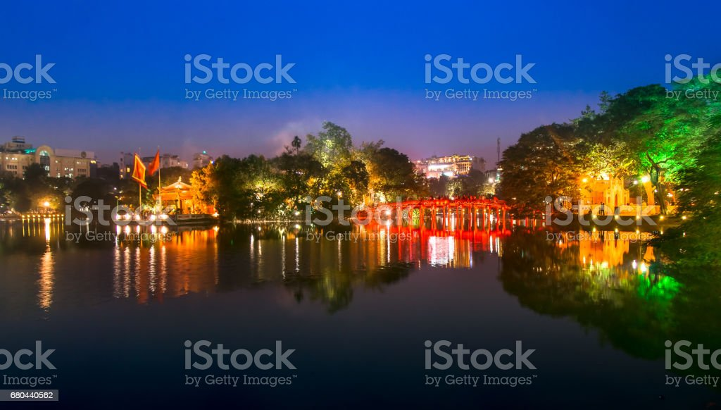Tourists visit Hoan Kiem Lake Public park at night time in Hanoi city. stock photo