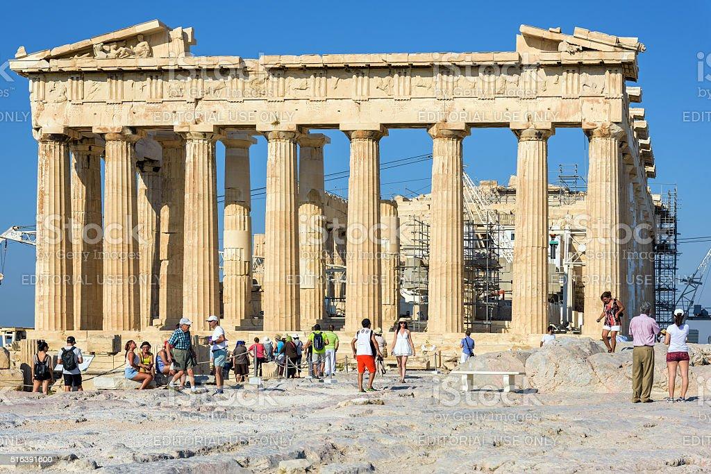 Tourists visit Parthenon temple at the Acropolis in Athens stock photo