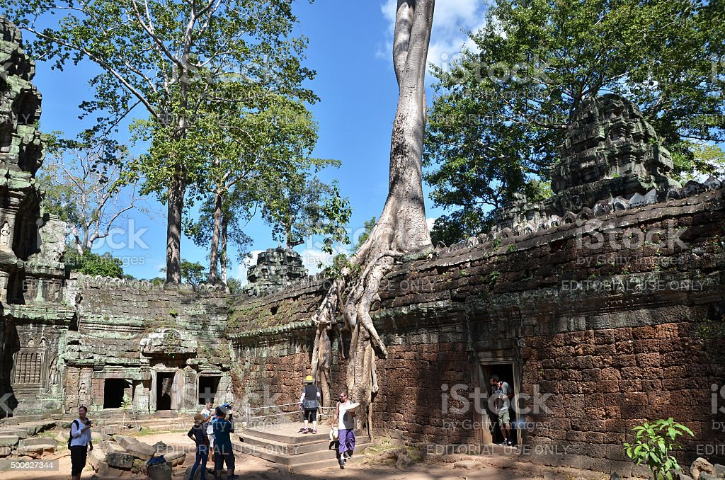 Tourists visit Ta Prohm temple at Angkor, Siem Reap stock photo