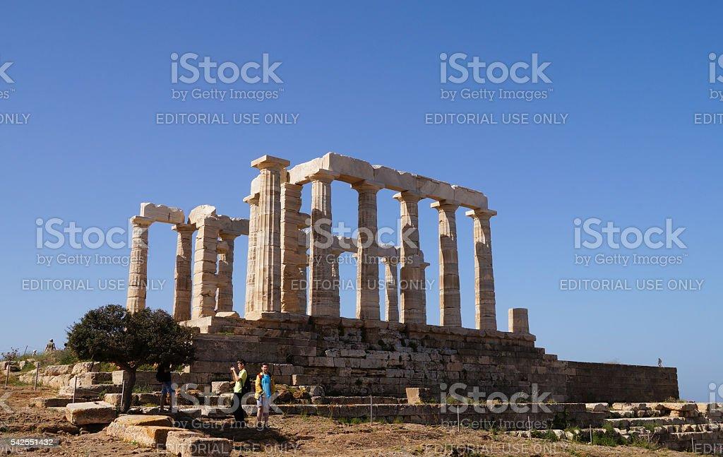 Tourists visit Temple of Poseidon at Cape Sounion,Greece. stock photo