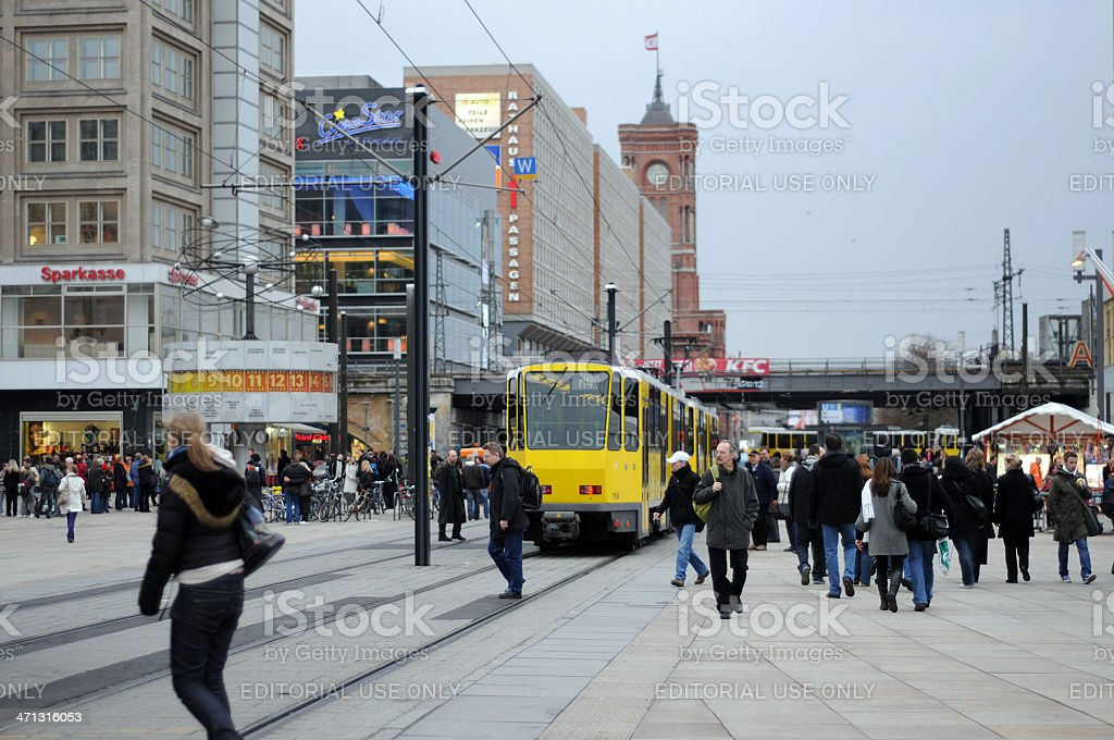 Tourists visiting at alexanderplatz in Berlin (Germany) royalty-free stock photo