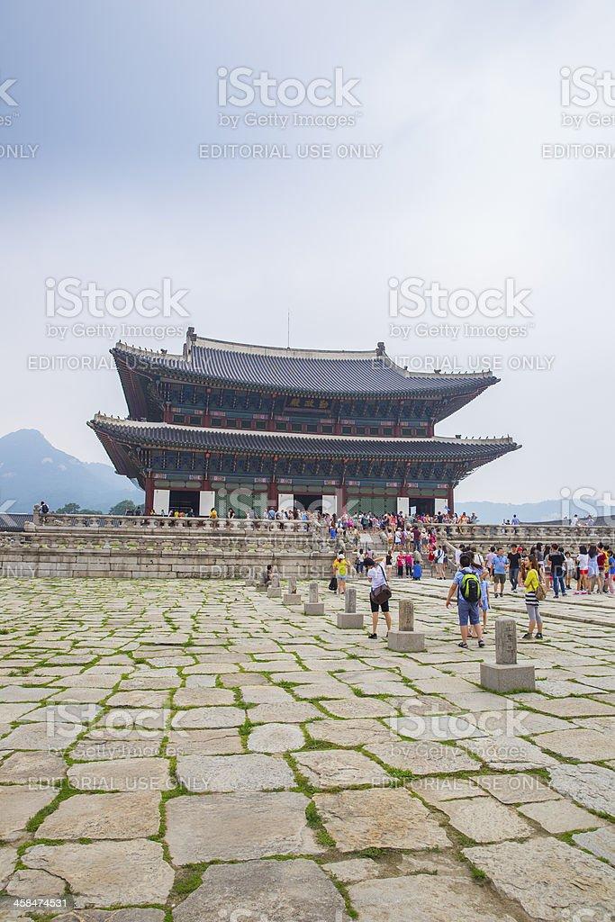Tourists Visiting Geunjeongjeon Hall at Gyeongbokgung Palace royalty-free stock photo