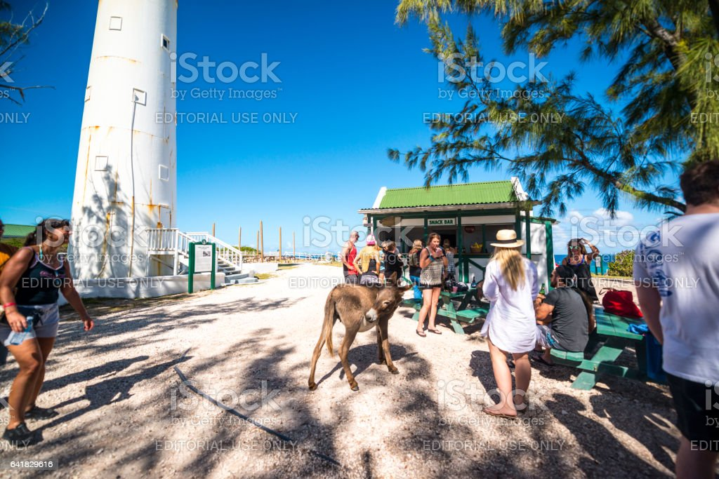 Tourists visiting Grand Turk Lighthouse, Turks and Caicos Islands stock photo