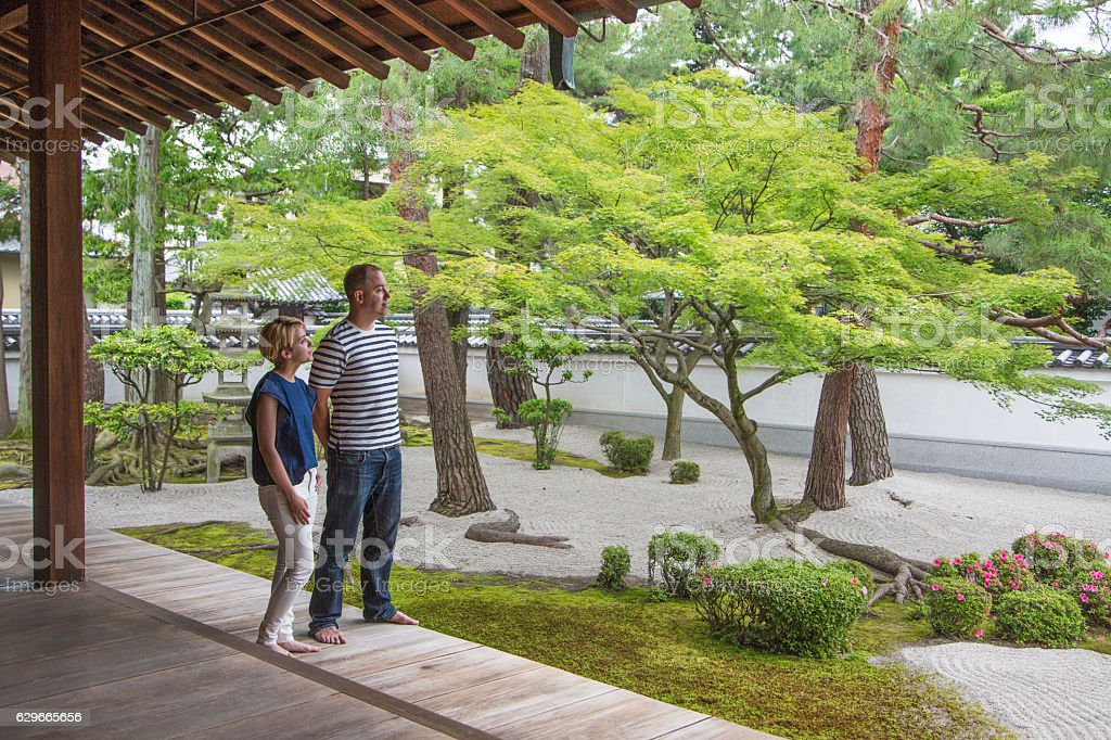 Tourists visiting Japanese Temple gardens stock photo