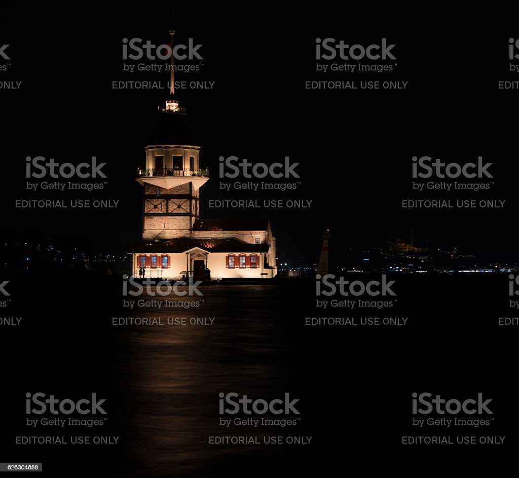 Tourists visiting Maidens Tower of Istanbul at night stock photo