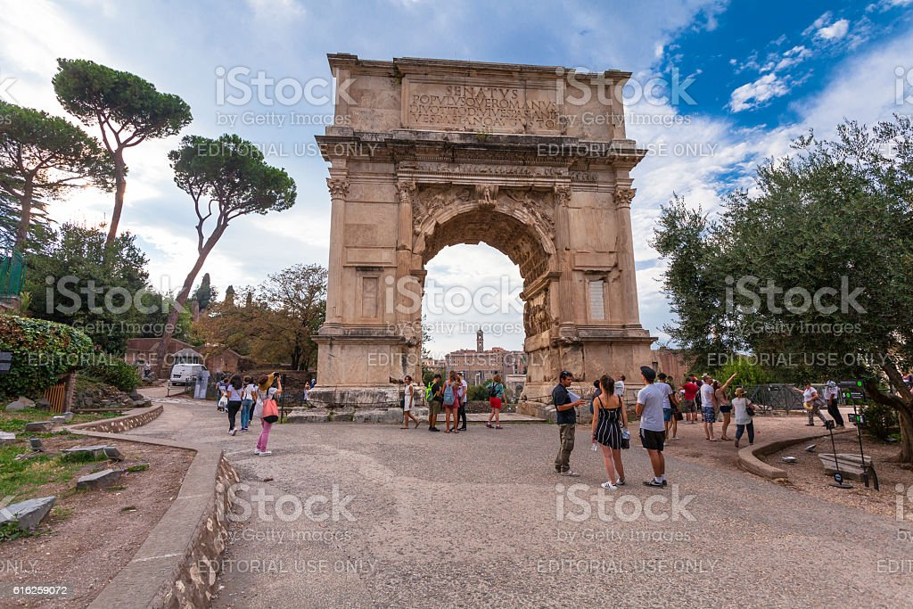 Tourists visiting the Arch of Titus in Roman Forum stock photo