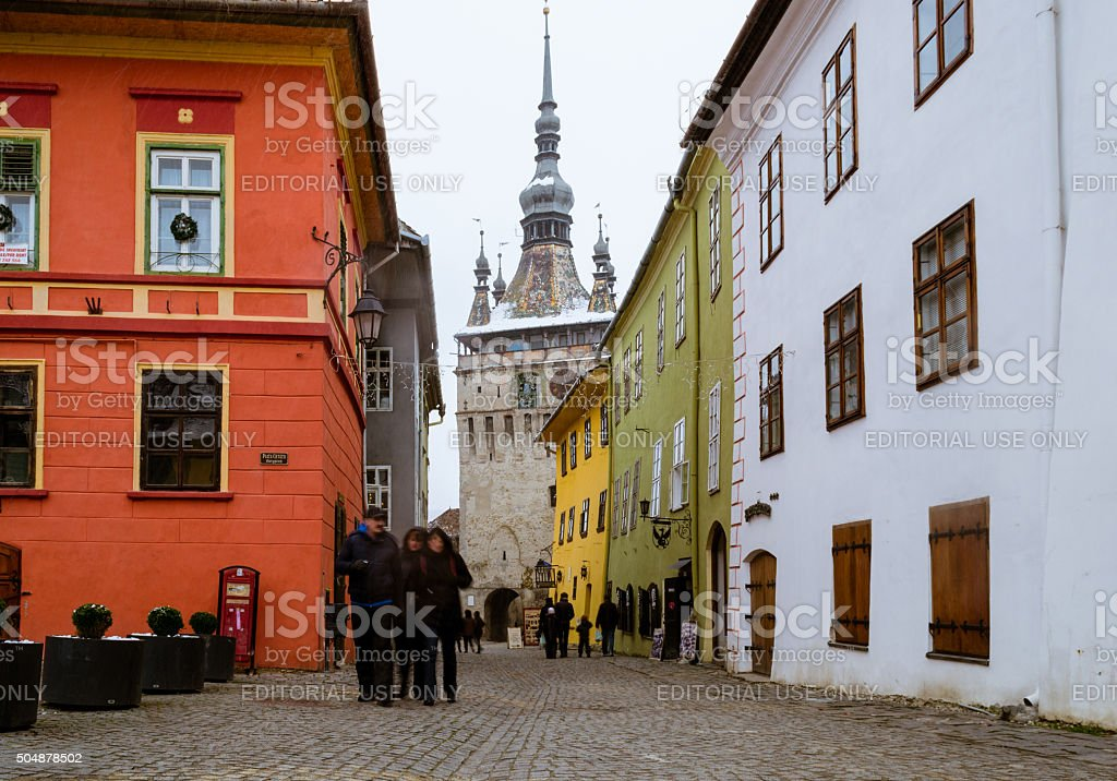 Tourists visiting the medieval citadel of Sighisoara in the winter stock photo