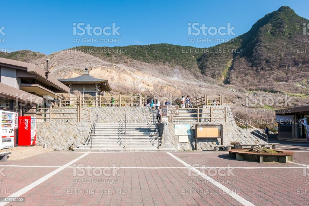 tourists visiting volcanic valley in owakudani stock photo