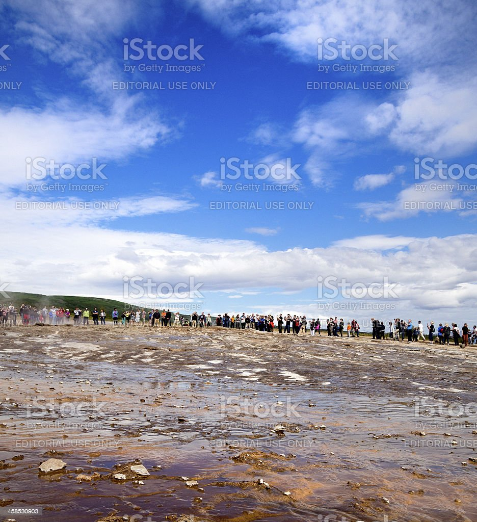 tourists waiting for eruption of Strokkur geyser on Iceland stock photo