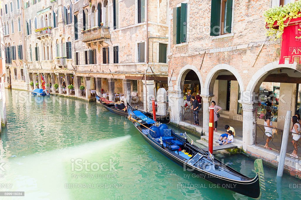 Tourists waiting for the gondolas in a canal in Venice stock photo