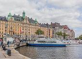 Tourists waiting sightseeing boats at Strandvagen street