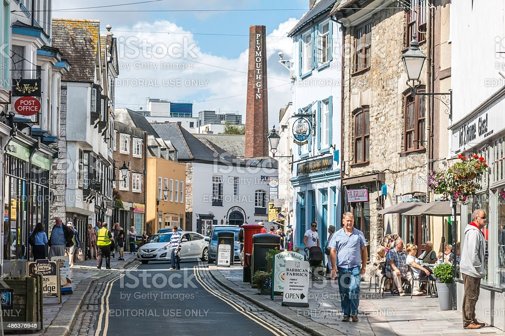 Tourists walk along Southside Street in the Barbican, Plymouth stock photo