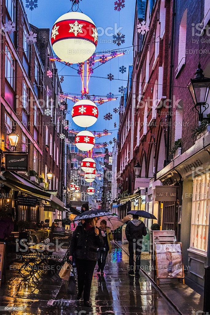 Tourists walk along St Christopher's Place at Christmas time stock photo