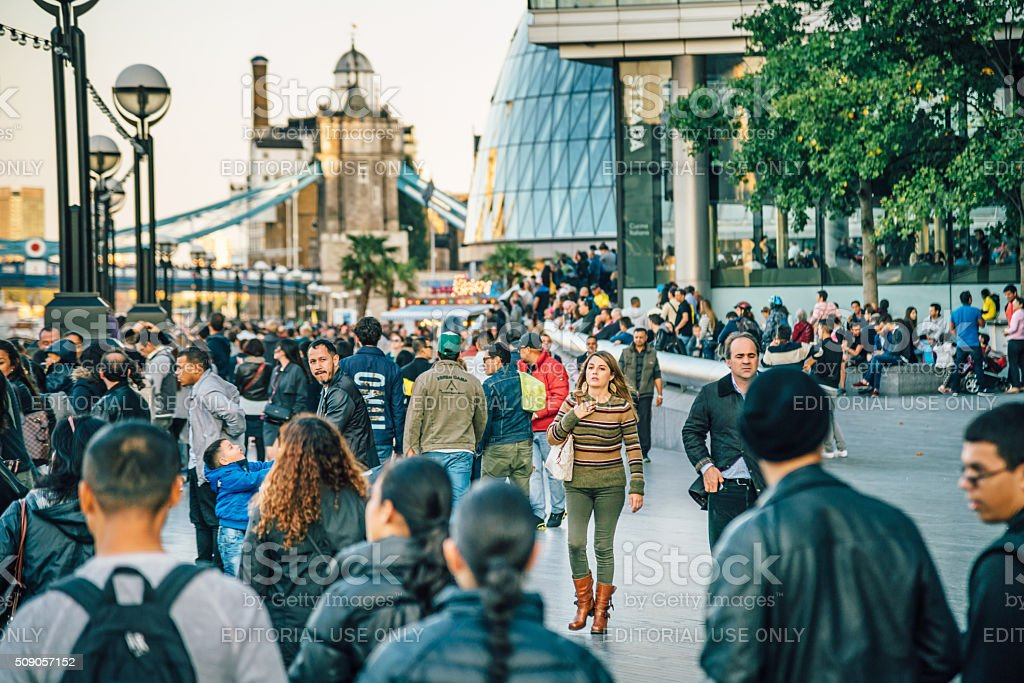 Tourists walk along the Thames stock photo