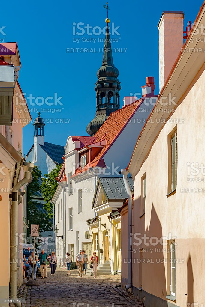 Tourists walk around in old town Tallinn at sunny day stock photo