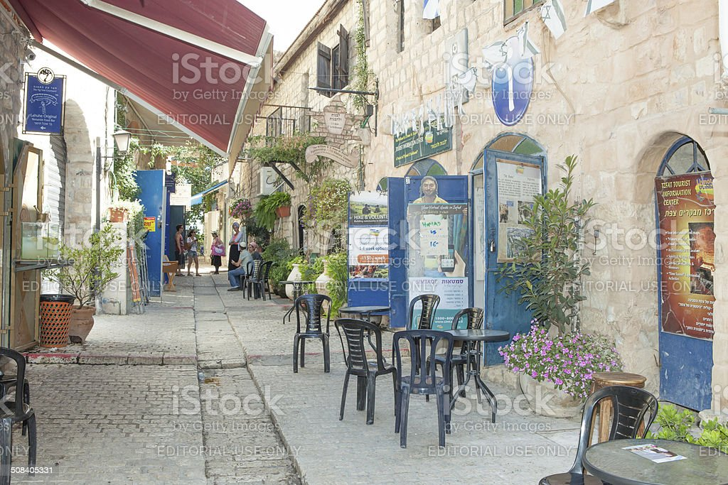 Tourists walk by shops and art galleries in Safed stock photo
