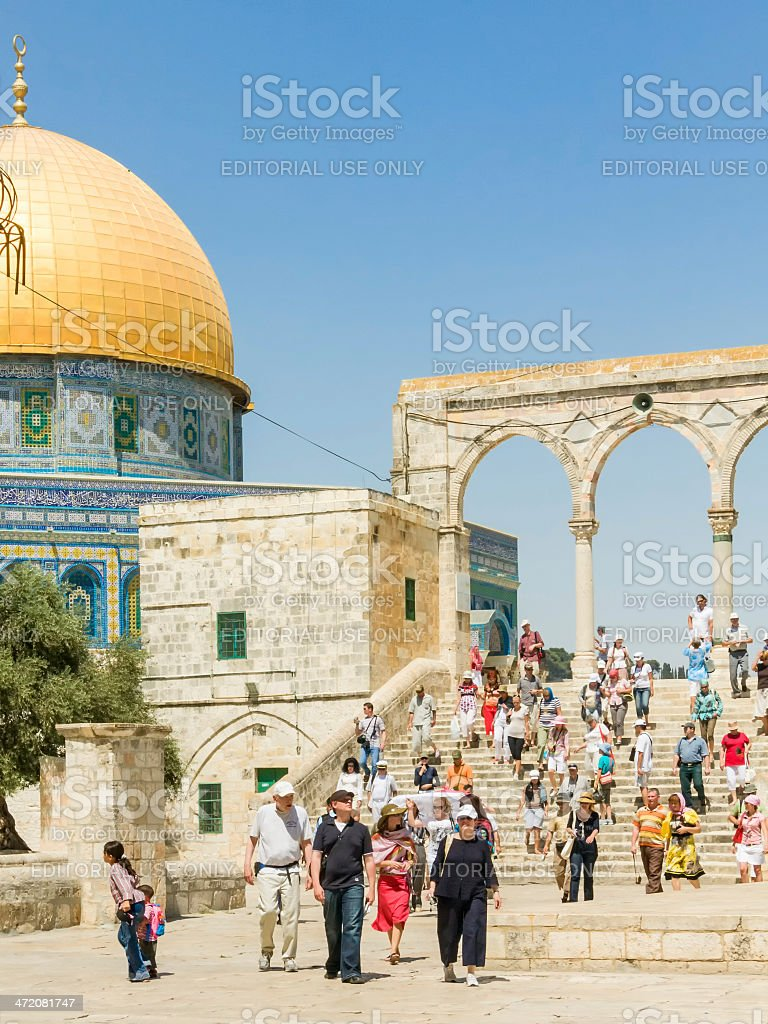 Tourists walk down stairs from Dome of the Rock Mosque royalty-free stock photo