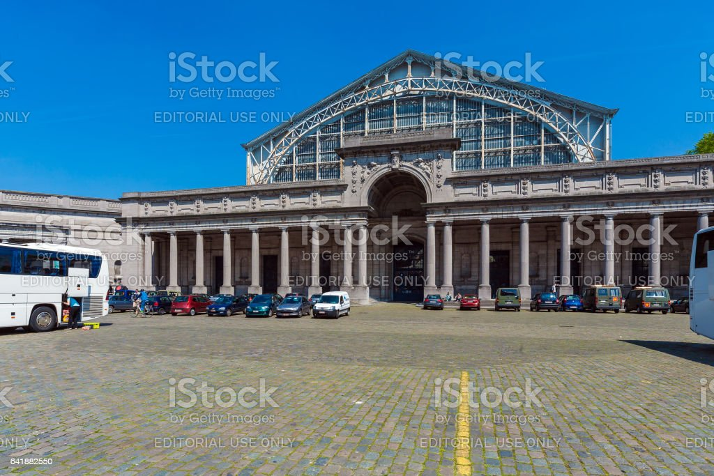 BRUSSELS, BELGIUM - APRIL 5, 2008: Tourists walk in front of Entrance to the Palais Mondial (South Hall) stock photo