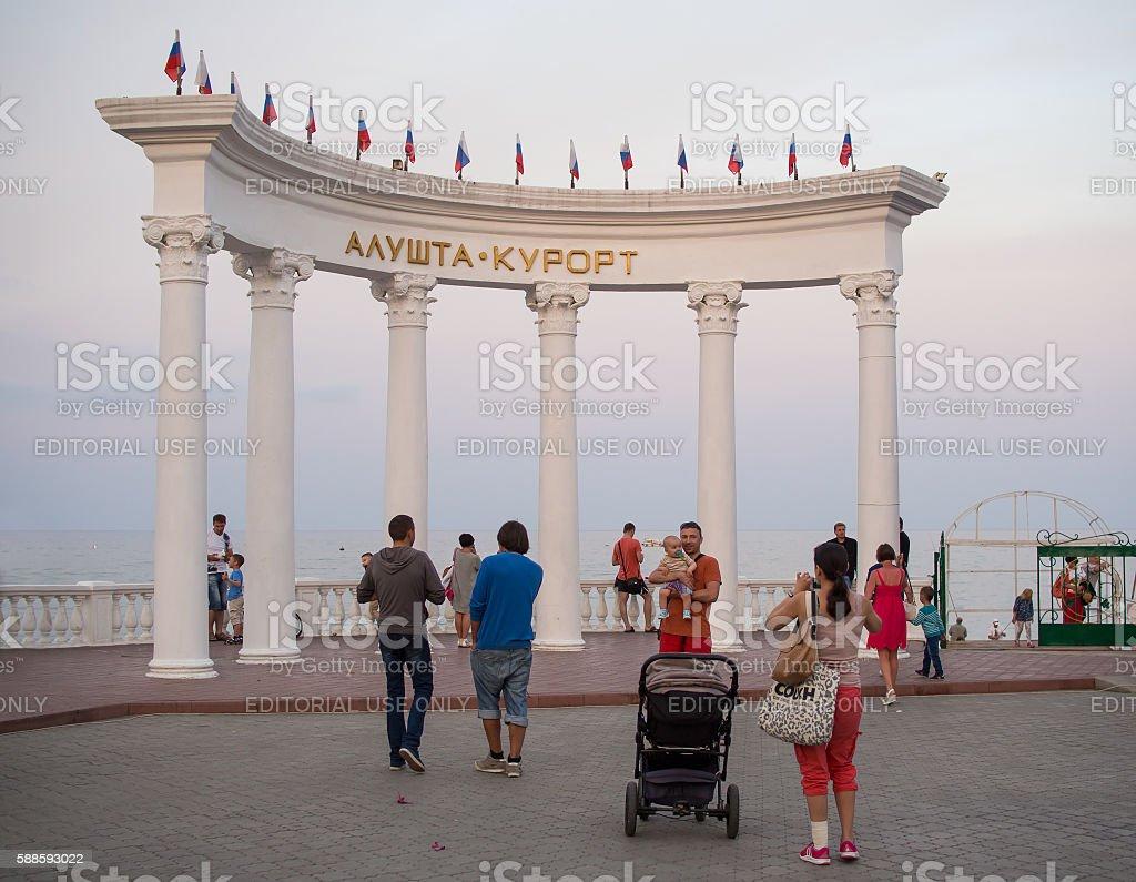 Tourists walk in the rotunda on the waterfront of Alushta stock photo