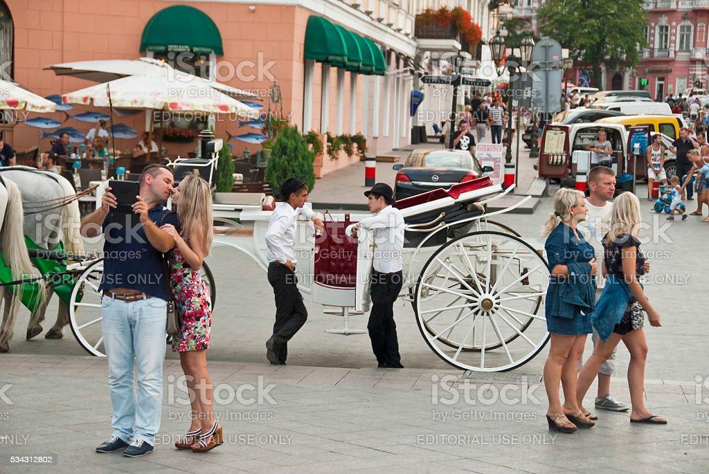 Tourists walk near Monument to Duke de Richelieu, Odessa, Ukraine. stock photo