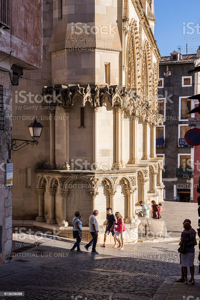 Tourists walk near the facade of the Cuenca's Cathedral stock photo